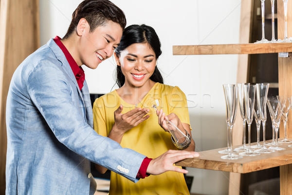 Asian couple buying stuff in furniture store Stock photo © Kzenon