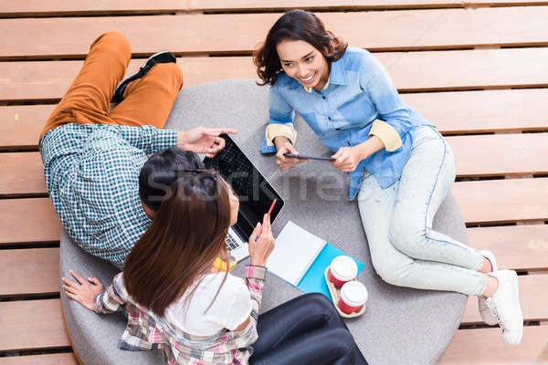 Three creative employees sharing ideas during brainstorming sess Stock photo © Kzenon