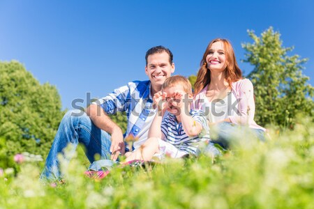 Family photo with father, mother and daughter in meadow Stock photo © Kzenon