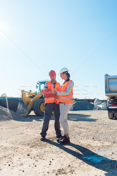 Worker and engineer on earthworks construction site planning  Stock photo © Kzenon
