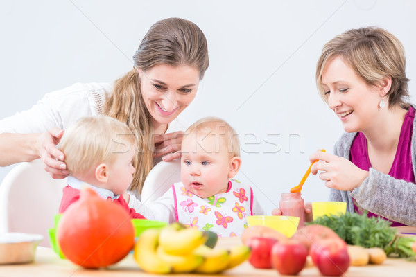 Portrait of a cheerful mother learning from her best friend Stock photo © Kzenon