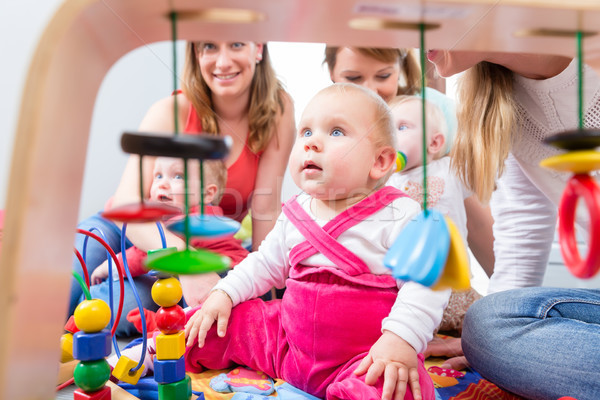 Cute baby girl looking up while sitting down on the floor at home Stock photo © Kzenon