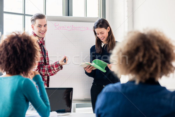 Students sharing ideas and opinions while brainstorming during class Stock photo © Kzenon