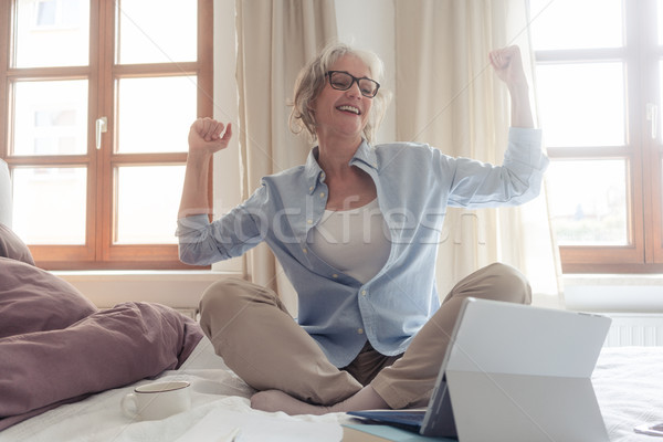 Senior business woman being excited about a success  Stock photo © Kzenon