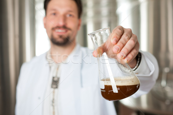Beer brewer in his brewery examining Stock photo © Kzenon