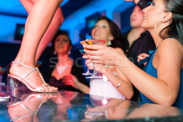 Woman in bar or club is dancing on the table Stock photo © Kzenon