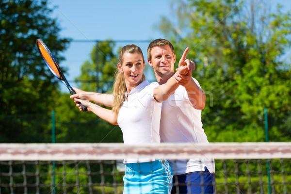 теннис учитель помогают женщину играть человека Сток-фото © Kzenon