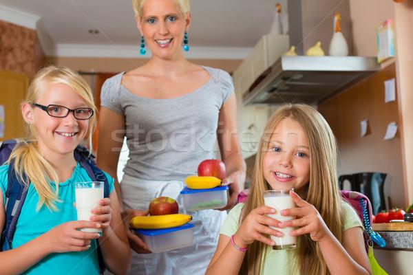 Family - mother making breakfast for school Stock photo © Kzenon