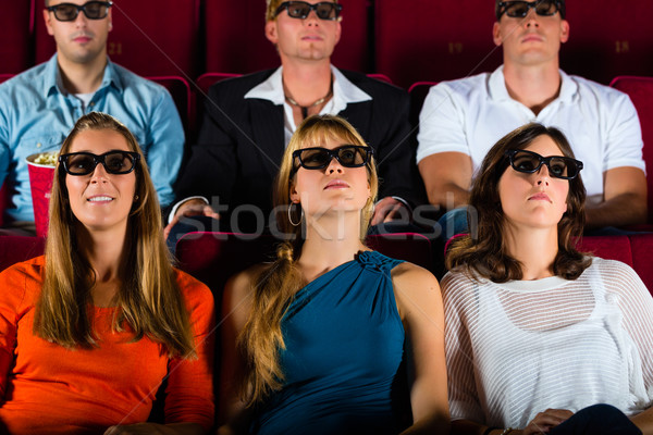 young people strained watching 3d movie at movie theater Stock photo © Kzenon