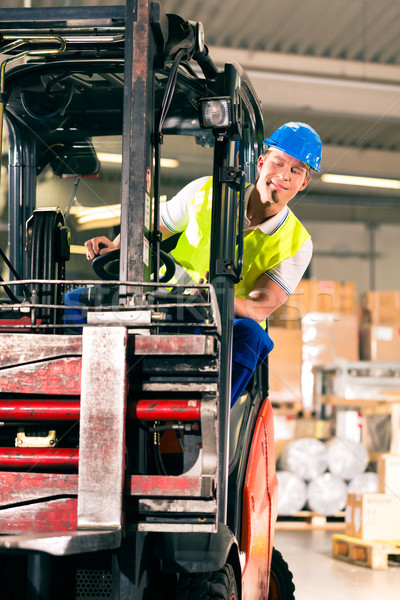 Stock photo: forklift driver at warehouse of forwarding