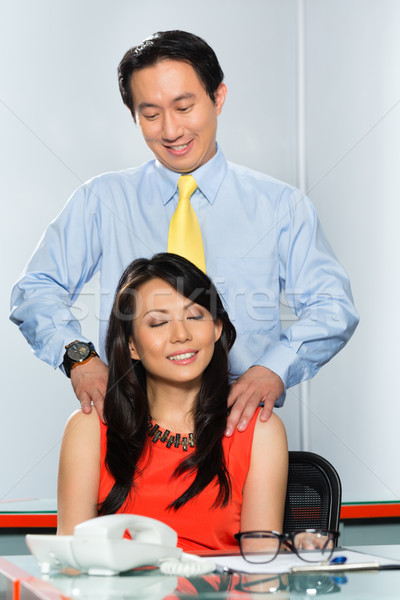 Asian Colleagues having office affair Stock photo © Kzenon