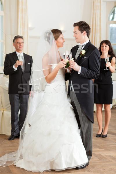 Bridal couple clinking glasses Stock photo © Kzenon