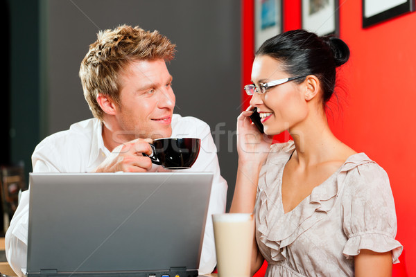 Couple in coffeeshop with laptop and mobile Stock photo © Kzenon