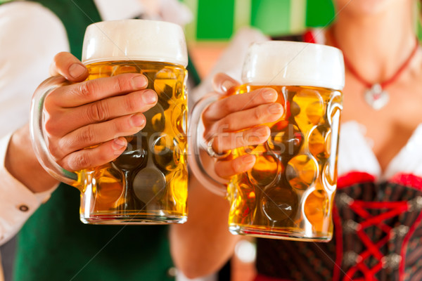 Man and woman with beer glass in brewery Stock photo © Kzenon