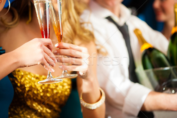 Stock photo: Couple with Champagner in club or party