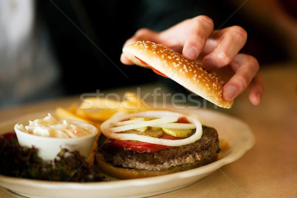 Adam restoran yeme hamburger lokanta açılış Stok fotoğraf © Kzenon