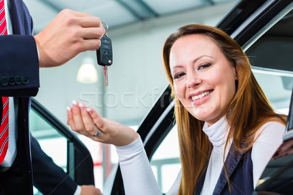 Dealer, female client and auto in car dealership Stock photo © Kzenon