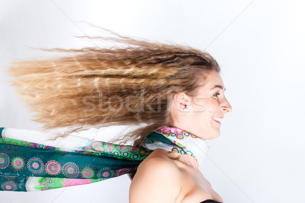 Long hair of woman with scarf blowing in head wind Stock photo © Kzenon