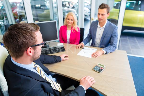 Pár tárgyal vásár kapcsolat autó vásárol Stock fotó © Kzenon