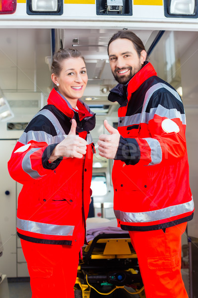 Emergency doctor in front of ambulance   Stock photo © Kzenon