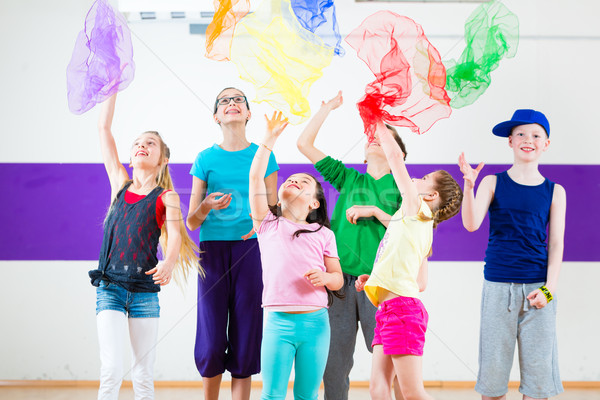 Kids in dancing class traninng with scarfs Stock photo © Kzenon