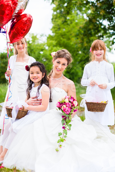Bride with girls as bridesmaids, flowers and balloons Stock photo © Kzenon