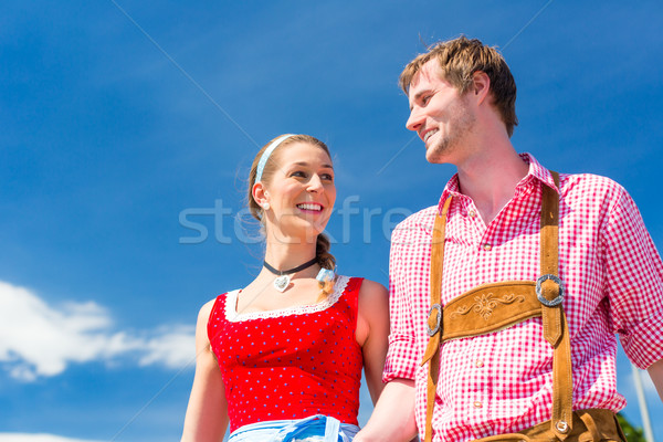 Couple visiting Bavarian fair having fun Stock photo © Kzenon