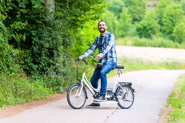 Man riding tandem bike on country lane Stock photo © Kzenon