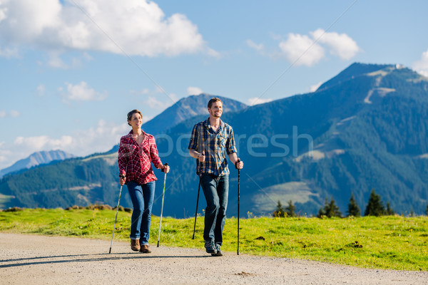 Couple doing nordic walking exercise in mountains Stock photo © Kzenon