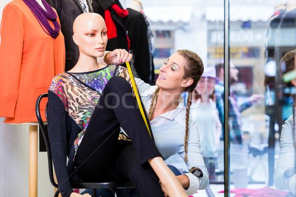 Small business owner dressing shop window Stock photo © Kzenon
