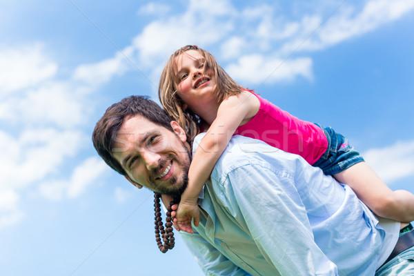 Apa hordoz gyerek háton hát kék ég Stock fotó © Kzenon