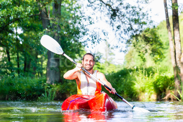 Man paddling with canoe on forest river Stock photo © Kzenon