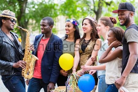 Több nemzetiségű csoport buli férfiak nők együtt Stock fotó © Kzenon
