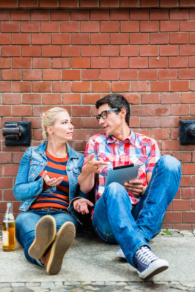 Hipster tourists planning Berlin vacation with pad computer Stock photo © Kzenon