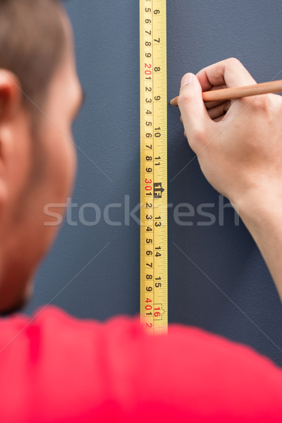 Stock photo: Young man sizing with tape measure