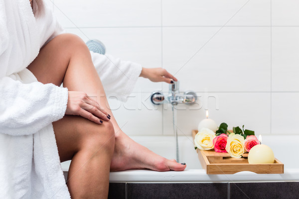 Woman preparing wellness bath in tub. Stock photo © Kzenon