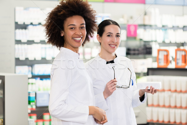 Portrait of a African-American pharmacist next to her colleague  Stock photo © Kzenon