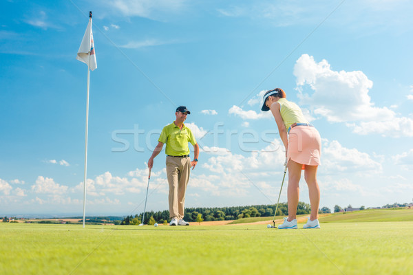 Female golf player ready to hit the ball Stock photo © Kzenon