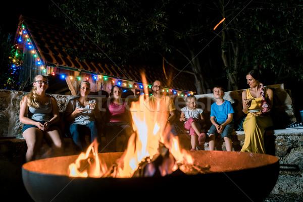 Stok fotoğraf: Aile · barbekü · parti · oturma · yangın · gece