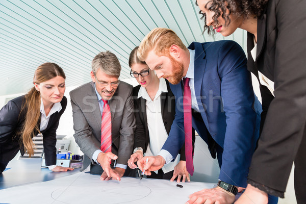 Group of business people analyzing data Stock photo © Kzenon