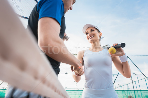 Tennis player man and woman giving handshake after match Stock photo © Kzenon