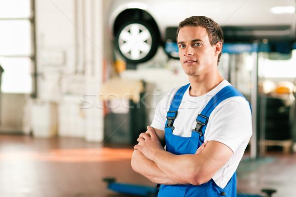 Car mechanic in workshop Stock photo © Kzenon