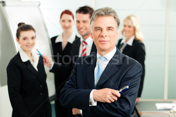 Business Team with leader in office Stock photo © Kzenon