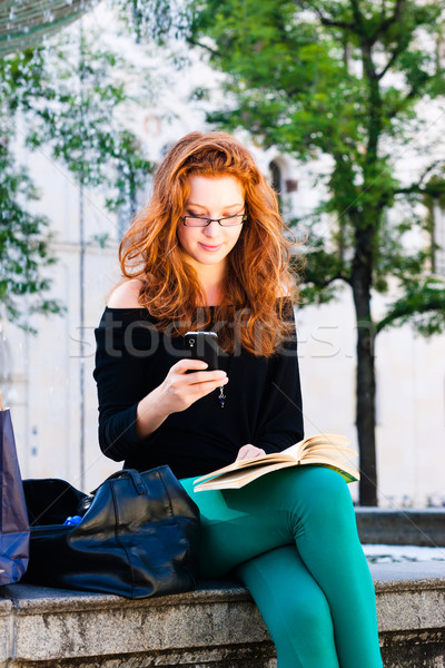 Young Woman calls with mobile phone in Park Stock photo © Kzenon
