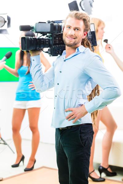 Stock photo: Cameraman shooting with camera on film set