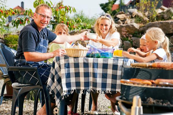 Family having a barbecue party Stock photo © Kzenon