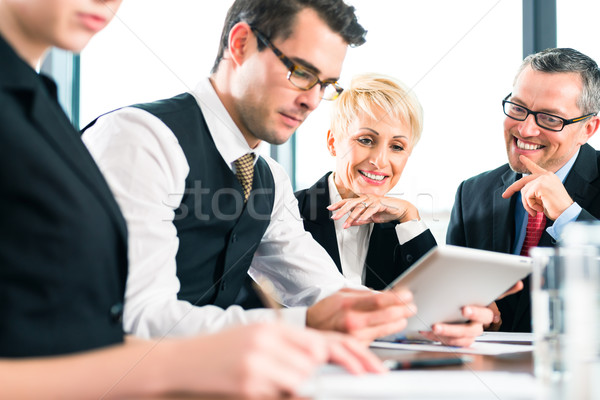 Business - meeting in office, team working with tablet Stock photo © Kzenon