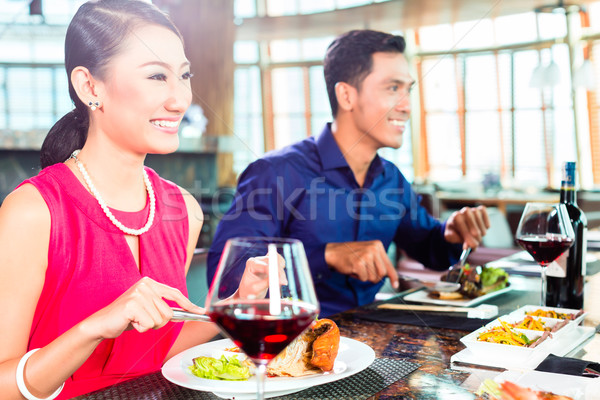 Asian people fine dining in restaurant Stock photo © Kzenon
