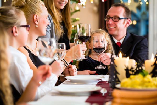 Family celebrating Christmas dinner Stock photo © Kzenon