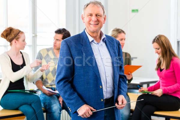 College professor in class with students Stock photo © Kzenon